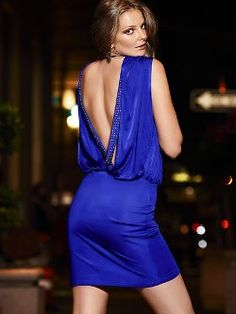 Stunning from every angle: the Open-back Crossback Dress from Victoria's Secret. This sparkly, strappy open-back dress has a retro look that's both daring and elegant. The crossover front drapes perfectly over the slim-fit skirt for an alluring silhouette.