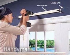 How to Build Window Cornices includes showing how to mount on the wall.  Might also work for a valance board.
