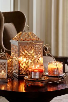 Infinite Circles Lanterns. Set your home aglow with vibrant autumn fragrances and décor that reflects the shimmer of the season.