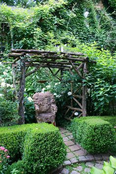 Vine clad house with wooden arch and decorative seat by KarlGercens.com, via Flickr