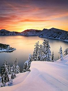 Sunset and snow at Crater Lake, Oregon.