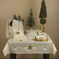"Noel Ecru Table Runner by WMU. $112.36. Noel Oblong Table Runner. Holiday runners with embroidered and applique details. Measures 14"" wide by 72"" length. Made of 100 % polyester. Warm wash, tumble dry low. Imported."