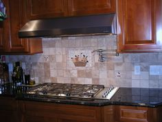 beautiful ceramic backsplash tile with wonderful black granite countertops and brown wooden cabinet also unique stove and glass