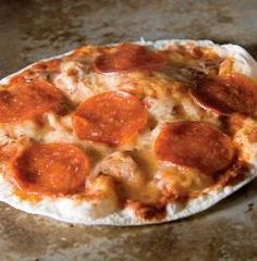 Pepperoni Tortilla Pizza delivers flavor with two kinds of cheese, and it's microwave-easy. Right under 400 calories. Seems like a good idea for lunch at work!