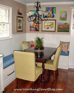 Original artwork collected over time fills the breakfast nook nicely in this remodeled kitchen