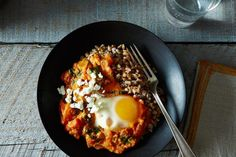 Shakshuka with Grains and Feta recipe: Saucy delight. #food52