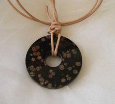 Black coral donut pendant w leather cord , fossilized black coral w lacy flowers , coral donut jewelry , round pendant , unique lacy pattern