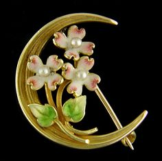 """Dogwood Honeymoon! The Victorians loved jewels with hidden meanings. For example small brooches with delicate enamel flowers set in a crescent moon, like this one, could be interpreted as """"honeymoon."""" The small dogwood blossoms beautifully crafted in pink and white enamel also held symbolic meaning. Perhaps this brooch was a gift from a husband to his wife on their wedding night or at the time of their betrothal. Created by Krementz & Company in 14kt gold, circa 1900."""
