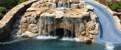 Pool grotto under waterfall and slide — by Boscoe's Pools