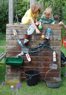 Water wall- Make a water wall! Screw items (look for clean bottles and containers in your recycling) into a piece of wood and cut holes in each item to create paths for water to trickle down. Add a collection bucket underneath so children can scoop out the water and do it again!