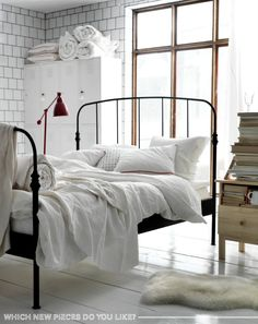 Love the wrought iron bedframe. It's either this or a four-poster :)