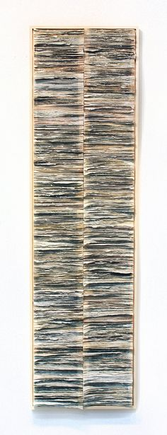 Spine 2 By Jessica Drenk - pages have been hand torn. The remaining book spines are then assembled to create this spinal column.