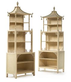 FROM THE ESTATE OF BROOKE ASTOR A pair of Regency style cream and green painted pagoda-form standing bookcases