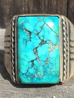"""Very worn old Navajo men's ring of sterling silver with a natural spider web turquoise stone.  Size: 10 Weight: 11 grams. Face measures: 3/4"""" wide. Silver is w"""