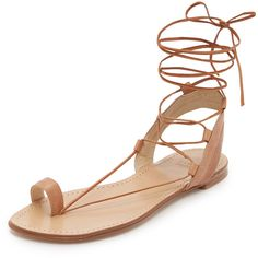 Stuart Weitzman Lasso Flat Sandals ($220) ❤ liked on Polyvore featuring shoes, sandals, camel, lace up flat shoes, camel sandals, leather shoes, flat shoes and toe loop sandals