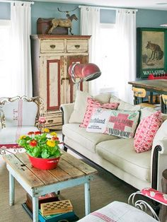 Wonderful red accents in this flea market style living room