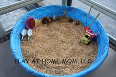 corn pit - so much less messy than sand  You could also do a bean & rice table.