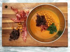 Spicy sweet potato&chipotle soup with bacon, caramelised onions, smoky chickpeas, coriander