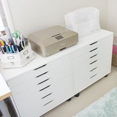 Next to my desk are two large Alex drawers (Ikea) and they hold a ton of stuff also! On top is my tool caddy, photo printer and sewing machine. In the drawers hold adhesives, embellishments, LOTS of collections from design teams. I love these drawers and in my dream (much bigger) room I would have more of them! Next week I will show you inside some of these drawers! #gailsnewscraproom #photoprinter