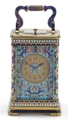 A SMALL CHAMPLEVÉ ENAMEL REPEATING CARRIAGE CLOCK, FRENCH, CIRCA 1895 gilt dial set in a polychrome champlevé enamel surround, gong striking movement No.1339 with ratchet tooth lever escapement, the rectangular glazed case with shaped handle and decorated with similar enamel on the corners and around the top and the base 12cm. 4¾in. high