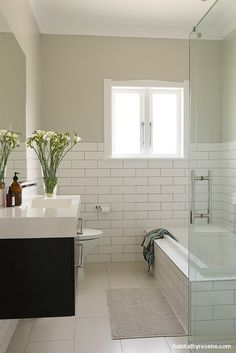 The bathroom has had a stylish and modern makeover, painted in Resene Merino. Photo by Helen Bankers/Cave. Small Bathroom Paint, Small Bathroom Colors, Bathroom Paint Colors, White Bathroom, Bathroom Pass, Paint Colours, California Bungalow Interior, Bungalow Interiors, Bungalow Renovation