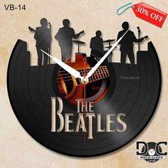 http://mlb-s1-p.mlstatic.com/relogio-de-parede-disco-de-vinil-the-beatles-vb-14-8139-MLB20001161820_112013-O.jpg