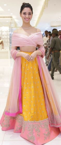 Beautiful Tamanna Bhatiya in Anushree Reddy pink and yellow lehnga | Yellow lehenga with light pink off shoulder blouse | Light lehenga | Lehenga inspiration for Indian brides | Sangeet outfit inspiration| Designer Lehengas | Image source: Pinterest | Every Indian bride's Fav. Wedding E-magazine to read. Here for any marriage advice you need | www.wittyvows.com shares things no one tells brides, covers real weddings, ideas, inspirations, design trends and the right vendors, candid…