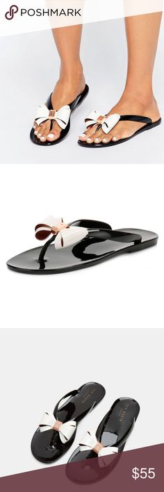 TED BAKER Bow Flip Flops NIB! In Black Multi Take a stroll across idyllic beaches in these elegant flip fops. Designed with a sophisticated curved bow and patent finish, this pretty pair will add Ted's quintessential style to your holiday wardrobe.  *Bow detailing  *Metallic Ted Baker-branding *Upper: 100% Polyvinyl Chloride; Sole: 100% Polyvinyl Chloride  ❌NO TRADES  I❤️Bundles ❤️REASONABLE OFFERS ONLY PLEASE❤️ Ted Baker Shoes Sandals