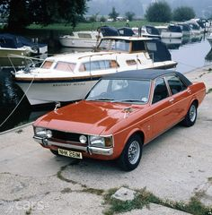 1974 Ford Granada with alloy wheels and black vinyl roof.