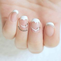 French Manicure with Negative Space Hearts - Unique Nail Design for Valentine's Day.