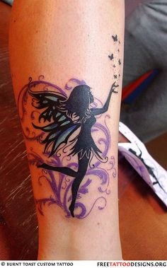 Girly fairy tattoo with blue wings