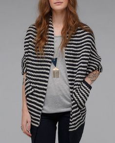 Striped shawl sweater, with cocoon-like fit, two side pockets, and contrast ribbing.