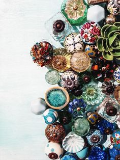 DIY knobs. Paint old furniture pieces and repurpose them. Add new beautiful knobs and WOW. World Market has many inexpensive choices.
