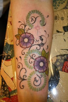 flowers and swirls. bea's arm, done back at Ink Minx in Montrose. charlotte ross.