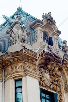 low angle shot of statues on building. - Low angle shot of elegant sculpture on building.