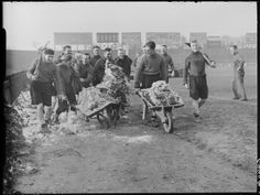 Fulham footballers clear snow from their pitch before Cup tie with Bury, 1939, Harold Tomlin © Daily Herald / National Media Museum, Bradford / SSPL