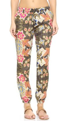 A vivid print accents these breezy Beach Riot pants. Concealed elastic at the waist and cuffs.