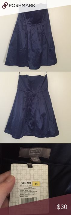 New Merona Navy Lined Strapless Dress New Merona Lined Navy Strapless Dress. Never worn. Wrinkled from being folded. New with tag attached. Tag on inner lining says it can be machine washed and tumble dry low with cool iron if needed. There are two small loop holes if you would like to attach a belt, but this item does not come with a belt. As pictured, it has a zipper and hook in the back. Merona Dresses Strapless