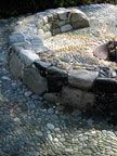 As long as I'm hypothetically covering my entire yard in stone mosaic, let's throw in this cozy built-in fire pit!