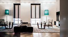 Cut down on glare with light filtering Roller Shades in material Spring. Shown in color Brown. | The Shade Store
