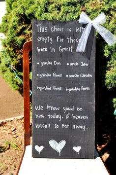 """We know you'd be here today, if heaven wasn't so far away"" wedding sign"