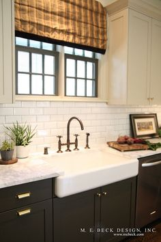 Vintage Inspired Kitchen, brass hardware.  dark lower cabinets, white uppers.