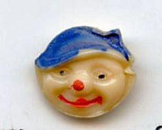 SOLD: PIXIE head glass button realistic vintage button