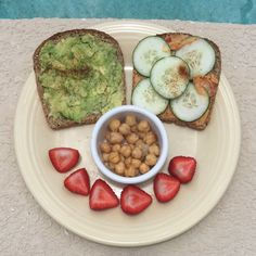Ezekiel Toast, One with Avocado and Cayenne Pepper, One with Hummus and Cucumber, Side of Chickpeas and Strawberries
