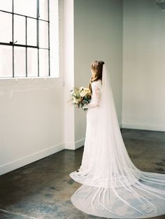modest wedding dress with long quarter and a fitted skirt from alta moda (modest bridal gown)