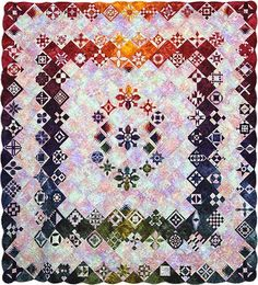 Jeepers ... it's Jane! This contemporary version of a Dear Jane quilt is made from hand dyed cotton fabrics set on a multi-color batik background. The appliqué blocks are satin stitched and enhanced with 73 different decorative machine stitches.