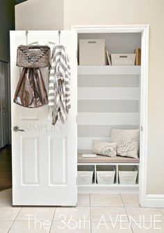 Mud room made in a hall closet || The 36th Avenue - love the stripes, love the simplify on the door, love the random little bench with pillows in a closet.  :)