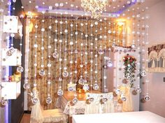 Add a beaded curtain across the kitchen windows to create a little sparkle. A respectable one, of course. And make it myself. -They sell a bag of clear beads at JoAnn for $3.99