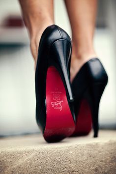 Black Louboutin heels.