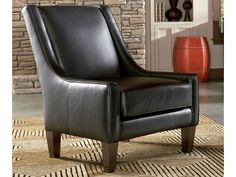 The Hobbs chair's classic design features low profile arms that sweep up to a slim, slanted back. It will bring striking, stylish appeal to your living spaces.